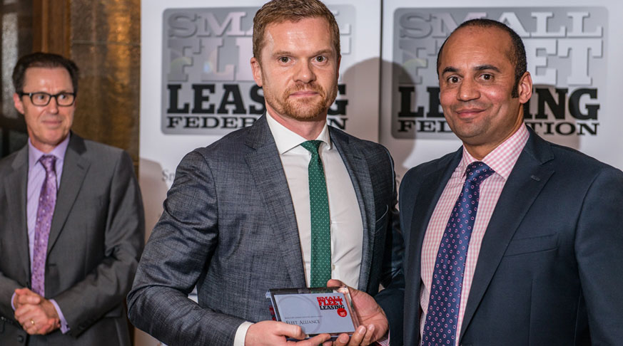 Martin Brown (left) receives an award from Small Fleet Leasing Federation award judge, Mark Gibson.